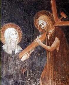 Kristus painaa ristinsä Chiara da Montefalcon sydämeen, mistä Chiara kärsi kipua lopun elämäänsä. [url=https://commons.wikimedia.org/wiki/File:Saint_Clare_of_Montefalco.jpg]Wikimedia Commons.[/url]